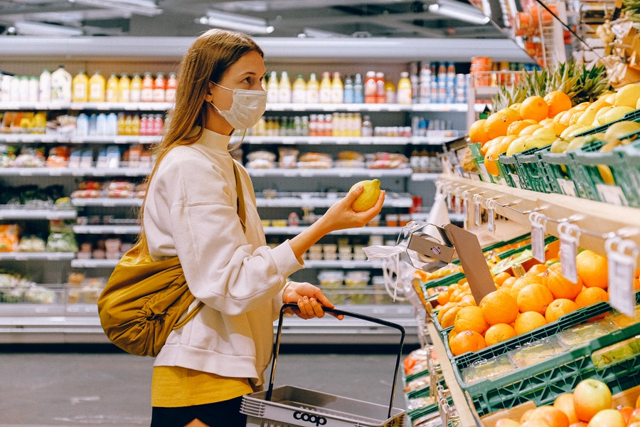 woman-in-Essential Foods to Store in Your Freezer During the Coronavirus Quarantineyellow-tshirt-and-beige-jacket-holding-a-fruit-3962285